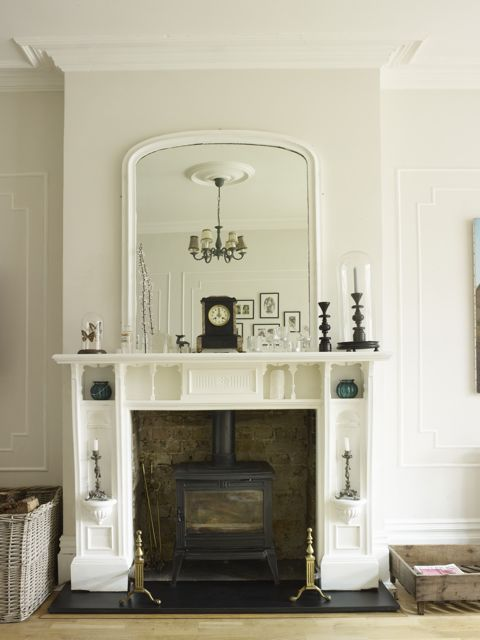 There wasn't really a design plan to this room, more of a slap-dash, happy accident kind of situation. I worked with what was there (which was not much bar the mouldings on the walls, the high skirting boards and a very dark fire place), kept the walls quite light (Farrow & Ball Strong White) and painted the fire place in Farrow & Ball's All White, added a big mirror above it to maximise light in that room.: