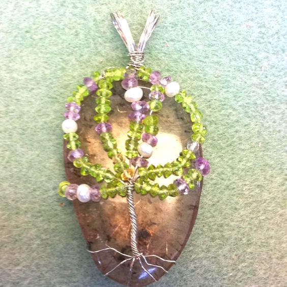 Another Michael Rayburn original! A tree of life set on a beautiful Agate! Fresh water pearls, Peridot, and Amethyst gemstones used on this project! Perfect colors for spring and summer!