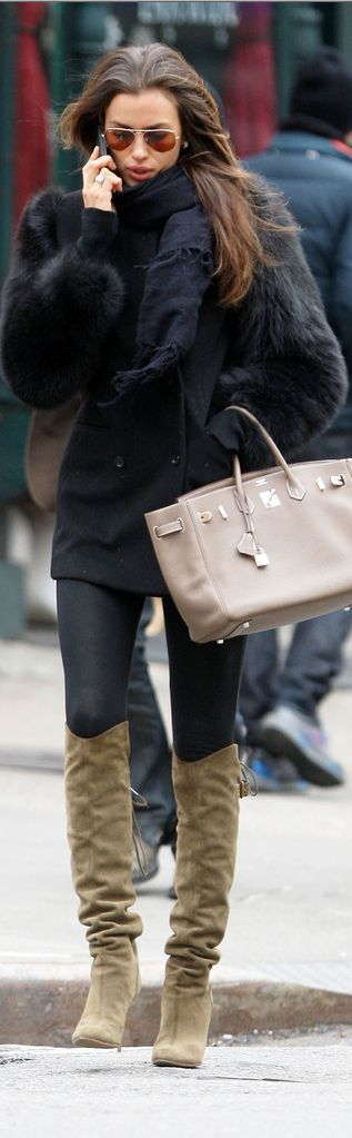 Bundled up for snow!I would so wear these boots and the purse for sure.. A must have for me !!