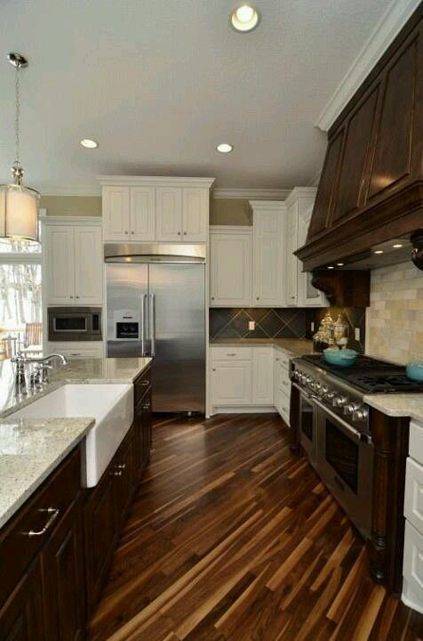 diagonal wood flooring two tone cabinets subway tile backsplash