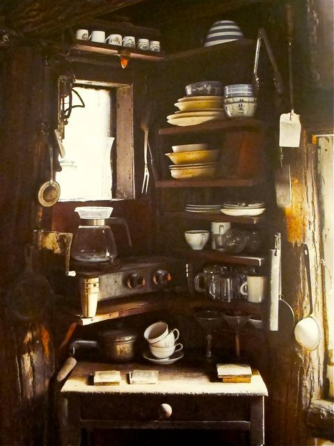 coffee/tea nook: corner shelves in far corner of kitchen or in dining room. Stacks of cups. Lots if mugs are perfect.