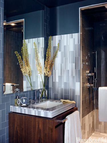 Masculine bath. A sleek navy and metallic powder room. Designed by James Michael and Phoebe Howard. housebeautiful.com #bathroom #bathroom_sink #walk_in_shower