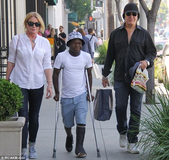 Focused on family: Gene Simmons and his wife Shannon Tweed were spotted with their foster son, Zinnah Sambolah, on Friday in Beverly Hills