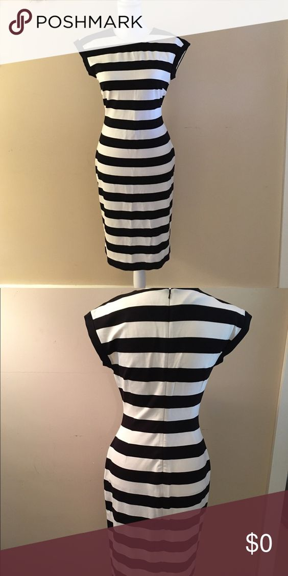 Banana Republic Dress w/a Choice of Necklace!! Size 6 NWOT. Plastic tag holder still embedded in material as it was never worn (tags just taken off). Banana Republic Dress. 37 inches long with a 34 inch bust. This dress has some give to it as it is made out of 89% rayon, 9% nylon and 2% spandex. Includes an accessory of your choice. WOW!!!!  Otherwise tag me and I will take $5 off the dress. Banana Republic Dresses Midi
