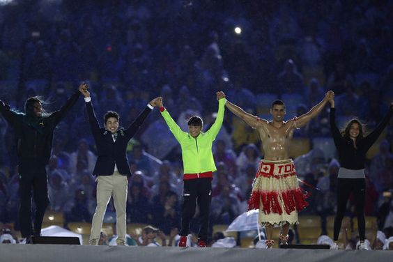 Kaori Icho of Japan, Yusra Mardini of the Refugee Olympic Team, Arthur Nory Mariano of Brazil, Shaunae Miller of Bahamas and Pita Taufatofua of Tongo on stage during the Closing Ceremony on Day 16 of the Rio 2016 Olympic Games at Maracana Stadium on August 21, 2016 in Rio de Janeiro, Brazil.