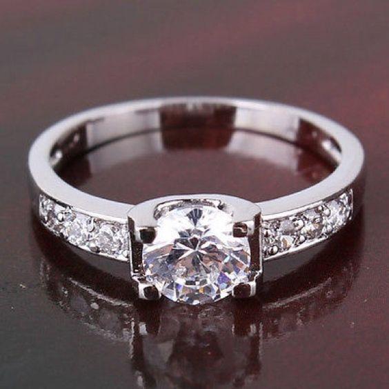 18k white gold filled 18k white gold filled white sapphire ring                            Material:Environmental copper Metal:White Gold Filled Color:White Metal Purity:18k Jewelry Rings