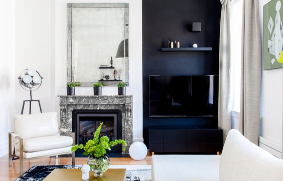 Photo by Alan Gastelum. Interior Design by The New Design Project. Eclectic Design.  Interior Design Inspiration. Industrial Interior Design. Industrial Design. Urban Interior Design. Black Wall. Mantle. Fireplace. Living Room.