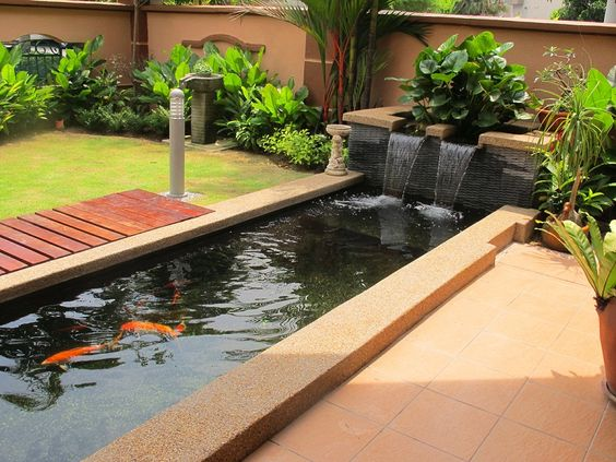 Waterfalls concrete materials and design design on pinterest for Large fish pond
