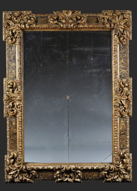 A RARE BAROQUE GILTWOOD AND BLACK LACQUER SECTIONAL MIRROR Probably Markina Xemein, Northern Spain. Late 17th/ Early 18th C. Height: 63″ (159.5 cm) Width: 46 1/2″ (118.5 cm) Depth: 4″ (10 cm).
