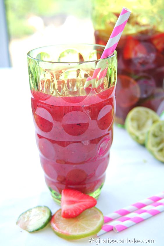 Frisky Summer Punch - a fruity punch drink made with apple and cucumber bison grass vodka, prosecco and fresh fruit. Perfect for summer parties, picnics and barbecues!