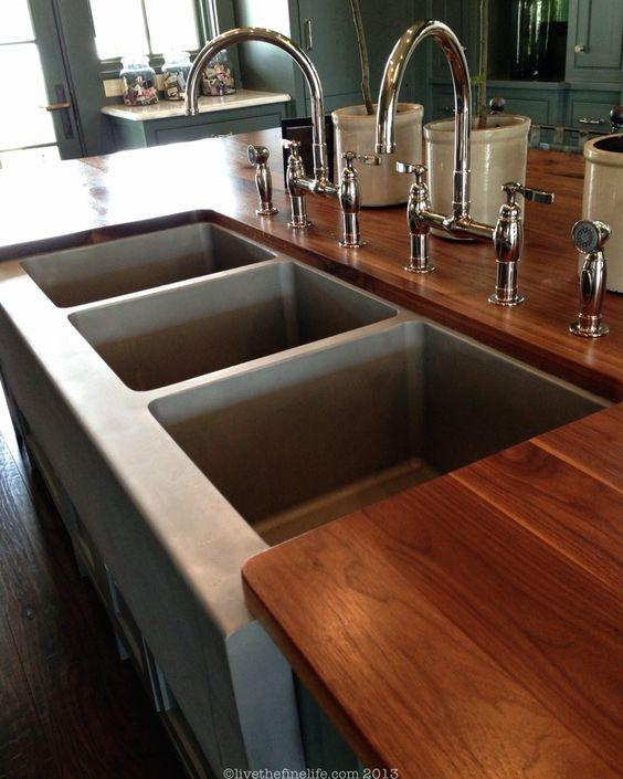 Bead blasted, commercial SS sink in a residential kitchen:: Southern Living Idea House. I love the countertops!!