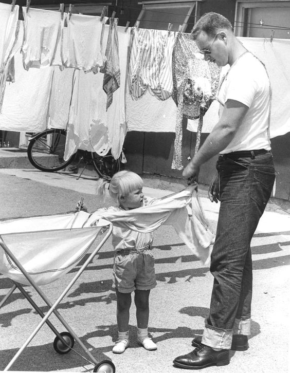 Glendale police officer Byron Green and his 2-1/2 year old daughter Vicki Ann hanging wash at the Glen Vet Court housing project on Colorado Street west of San Fernando Road in Glendale, August 1953. Housing up to ninety-nine veterans and their families, this city-owned project was built in 1946 to serve as temporary residence until the families were able to move into private housing. Glendale Central Public Library. San Fernando Valley History Digital Library.