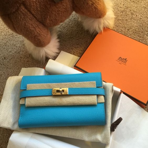 Hermes mini kelly wallet Gorgeous color ! Mini size and goatskin. Very rare. Hermes Bags Wallets