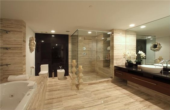 Contemporary Master Bathroom with Master bathroom, Flush, travertine floors, Simple Granite, Glass shower door, Shower jets