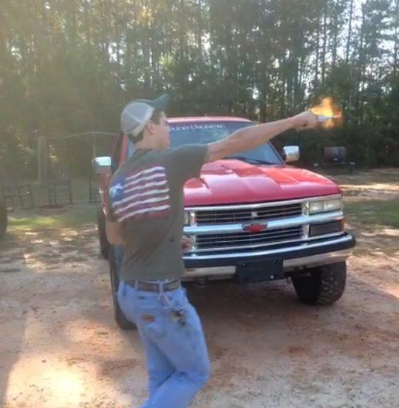 Country boy firing a gun