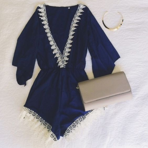Navy & white Romper Deep V Navy Romper. In great condition light weight fabric great for summer Unknown Dresses Mini