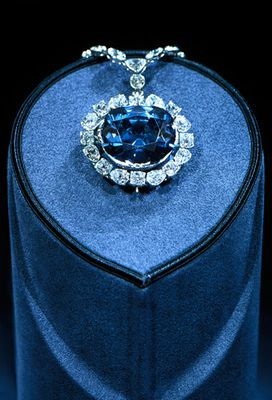"Hope Diamond ($250 million). Among the most romanticized jewels in the world, the Hope Diamond is housed at the Smithsonian's National Museum of Natural History and considered the second-most visited piece of art in the world (behind the ""Mona Lisa""). Discovered in India in 1812, the 45.52-carat blue-gray stone has had many owners over the years. The diamond is also said to be cursed—including the alleged suicides of several of its owners.:"