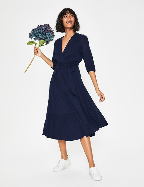 This Wrap Midi Dress Is All About Boho Luxe Right Down To The Floaty Tiered Skirt Three Quarter Length Sleeves An Boden Wrap Dress Wrap Dress Navy Wrap Dress