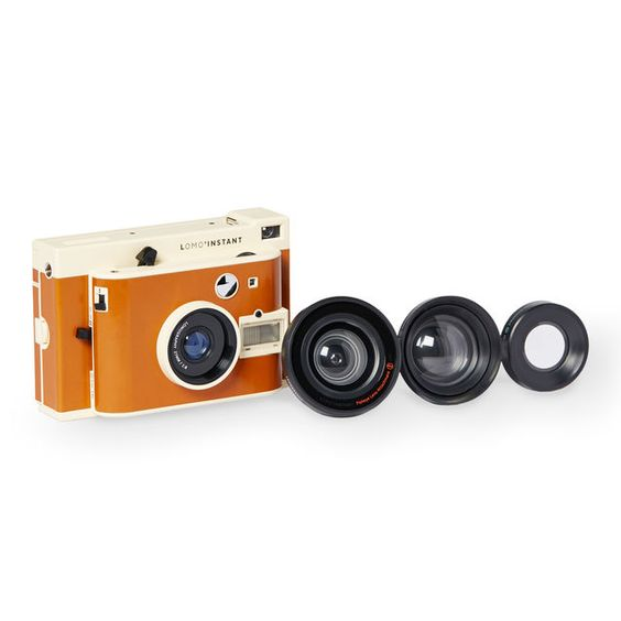A+slim,+vintage-inspired+instant+camera+with+wide-angle+lens,+4+color+filters+and+multiple+lens+attachments.