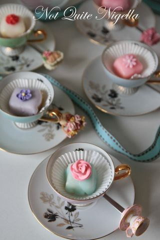 Petit fours in a tea cup. Would be a cute party favor wrapped in cello with ribbon.