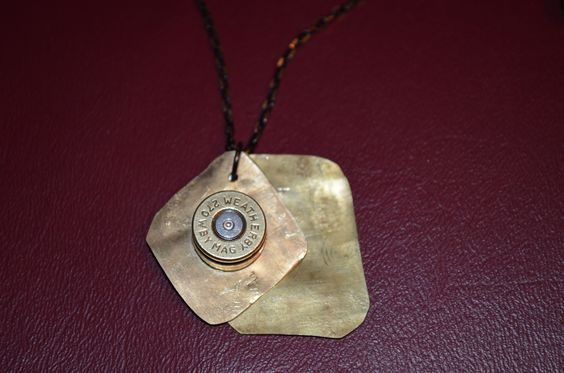 This is a Bullet Jewelry Design where Dad and I took a bullet casing cut it into squares and a flattened it. Then fix the biggest bullet he had in the middle.