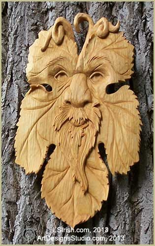 Green man relief carving by lora irish wood