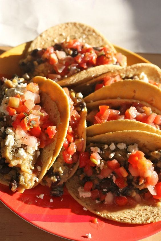 Crockpot Lentils  3/4 cup red lentils one can whole black beans half cup salsa verde  2 cups water Cook for a 2-3ish hours on low. Fill corn tortillas with lentil-bean mix, top with cheese and pico de gallo
