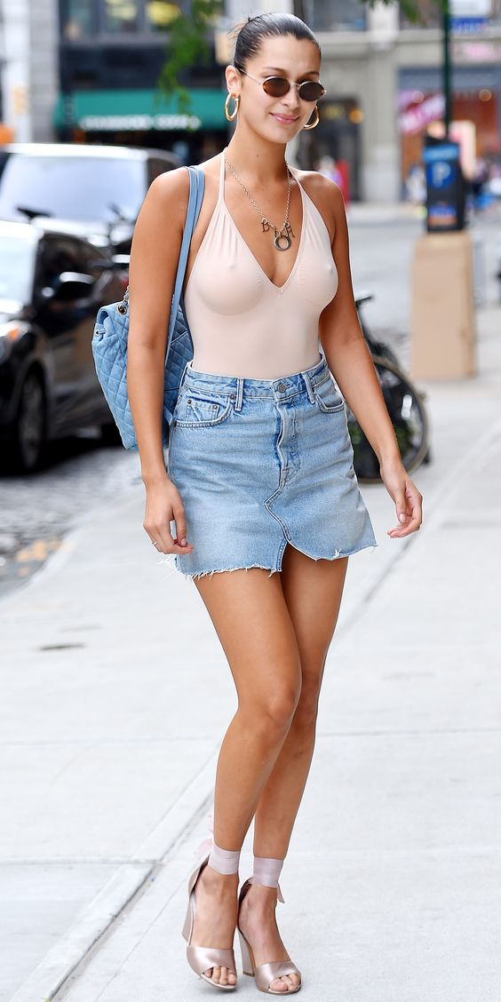 Bella Hadid showed us her take on the light denim miniskirt when she stepped out in New York City. She styled her Grlfrnd skirt ($158; revolve.com) with a blush bodysuit, matching heels, bold gold jewelry, retro sunglasses, and a Chanel denim backpack.