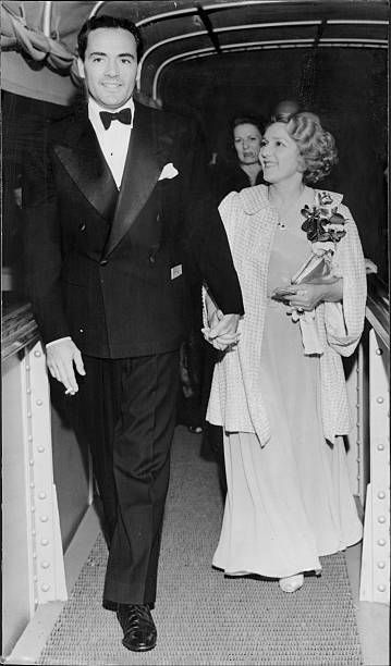 Mary Pickford and her band-leading husband. Buddy Rogers, hurried aboard the Normandie. May 21, 1936.