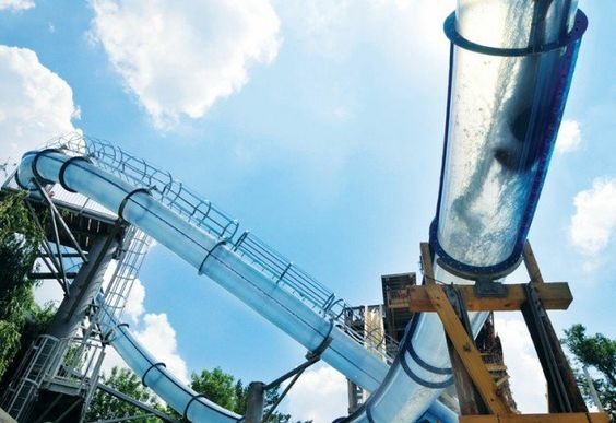 Scorpion's Tail: Noah's Ark Family Park, Wisconsin Dells, Wisconsin  ten-story high, one giant loop,  freefall drop to get you started. riders stand in a capsule for a few seconds until the ground abruptly gives way. Suddenly, that loop makes more sense, as it's the only thing slowing you down from the 2.5 gs of gravitational force driving you through the spray.