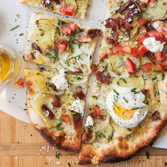 Baked Potato Pizza - Topped w/ Yukon gold potatos, bacon, sour cream, tomatos, and chives.     http://www.bhg.com/recipes/from-better-homes-and-gardens/september-2012-recipes/#page=2/