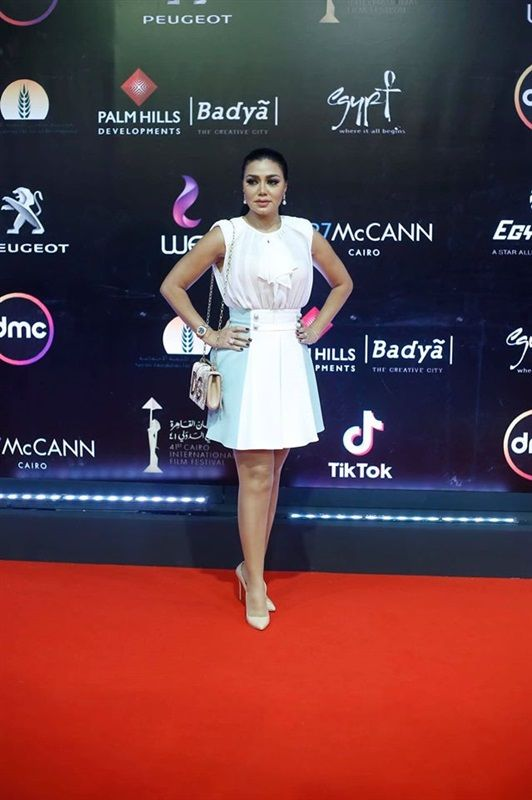 بـ فستان أبيض فوق الركبة رانيا يوسف تخطف الأنظار على السجادة الحمراء في مهرجان القاهرة السينمائي Formal Dresses Cocktail Dress Sleeveless Formal Dress