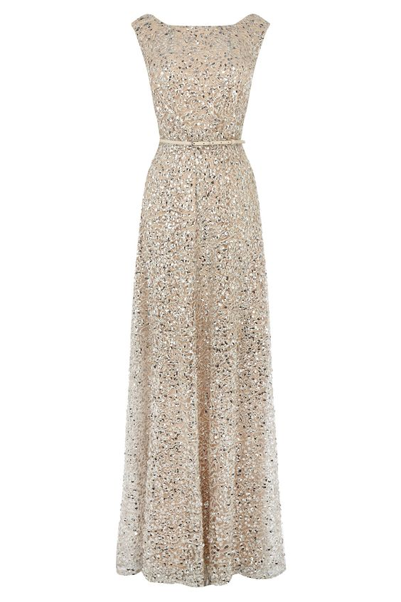 An exclusive Party Dress dripping in exquisite beading and dazzling sequins. The Desire Maxi Dress has been expertly crafted to luxuriously elongate your figure with a beautiful patent waistband that cinches you in at the waist making for a flattering fit. With a beautifully cut boat neckline this dress is a sensational investment that will be a lifelong, special part of your wardrobe. This fully lined dress is closed with a concealed back zip and is 135cm/53 inches in length from underarm…