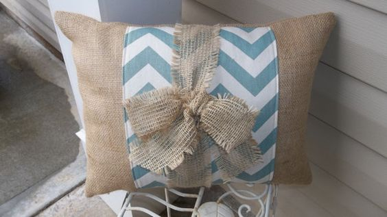 This Pillow is about 14 X 18 and is made from natural color burlap. The pillow had a 8 band of Grey Chevron Duck cloth down the center and is tied