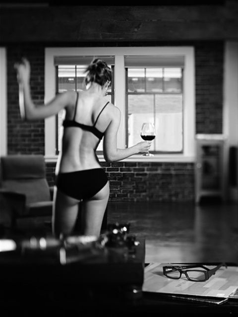 Just home from work lingerie and a glass of wine.