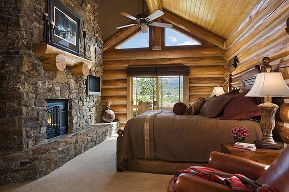 Handcrafted Log Home Bedroom Picture -love the setup and the doors to a balcony, and omg that fireplace!
