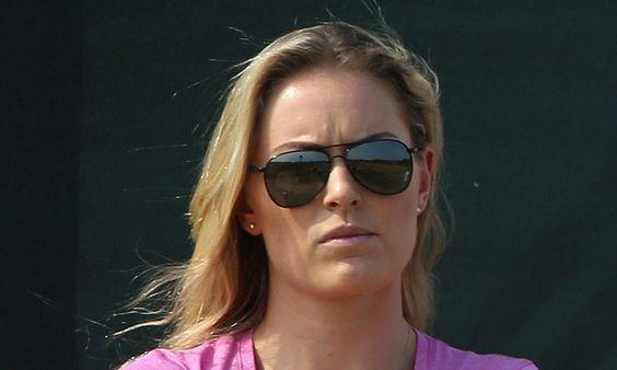 Lindsey Vonn looks glum watching Tiger Woods struggle in British Open