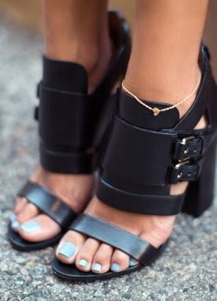 black heeled shoes with thick ankle strap and buckles. very