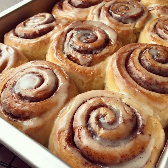 Cinnamon rolls from scratch! Tons of cinnamon sugar rolled inside and drizzled with a wonderful glaze on top! These are so delicious!