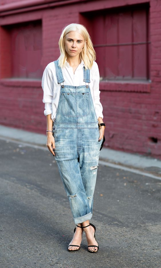 Denim overalls, sleek heels, and a white button up shirt via Always Judging #StreetStyle: