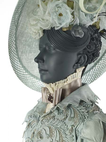This is a close up of the hat and hair from the blue pelisse above. It's actually quite pretty, even though it makes the outfit look much mo...