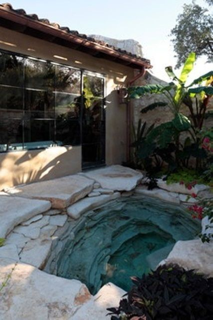 Beautiful natural stone hot tub.  48 Awesome Garden Hot Tub Designs | DigsDigs: