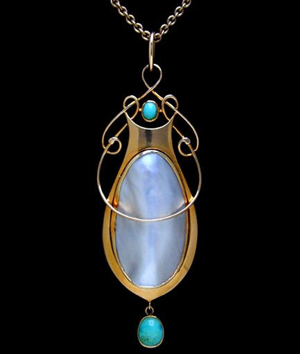 MURRLE BENNETT & Co. (1896-1914)   A gold pendant set with a central pearl plaque with a turquoise set above, flanked  by wirework entrelac motifs. A turquoise drop below.  Anglo/German c.1900. Marks for MB & Co. and 15 ct. (Pendant case)  Size: Length of pendant with bale 6.7 cm. Without bale 6 cm. Width 2.3 cm.   Lit.: Art Nouveau Jewelry. Vivienne Becker. Liberty Style. Academy Editions