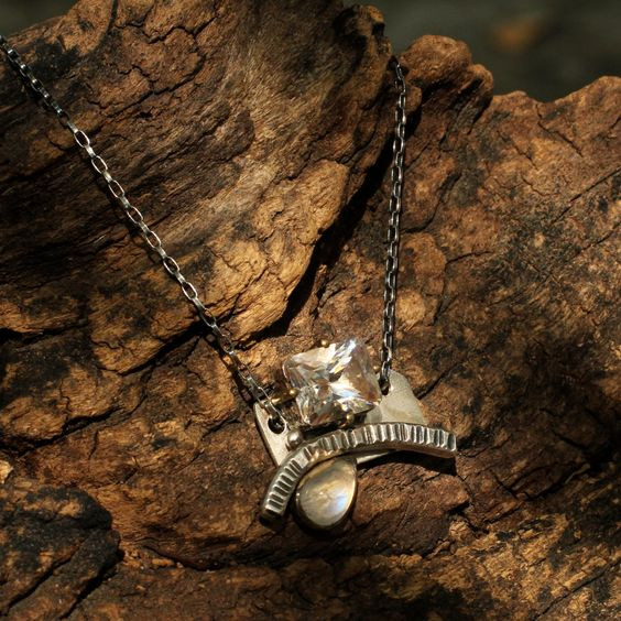 White topaz pendant on silver hand crafted backing with secondary moonstone gem