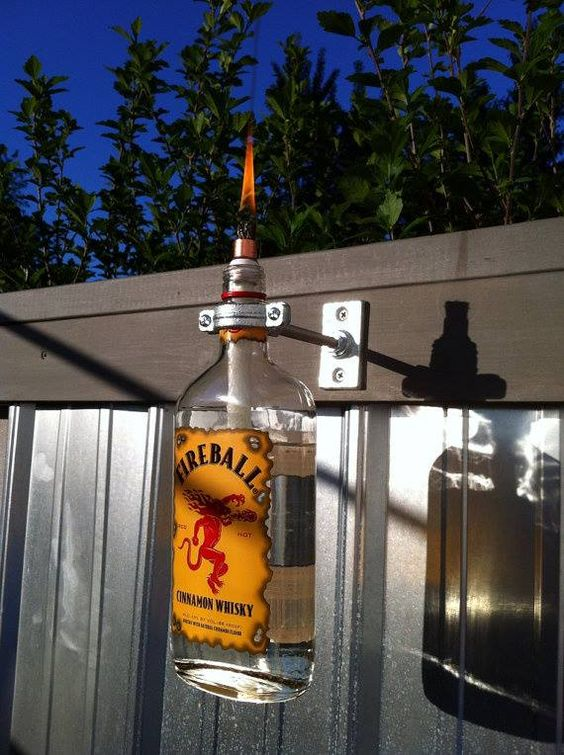 a fireball whiskey tiki torch! this is brilliant! @A Whole Lotta Love And Theft posted this!