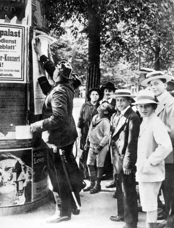 WW1. A German policeman posts a mobilisation order in Berlin at the beginning of…