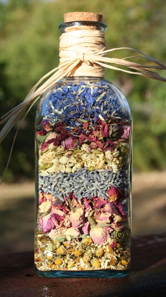 Dried organic flowers in a recycled green glass bottle for Flowers in glass bottles