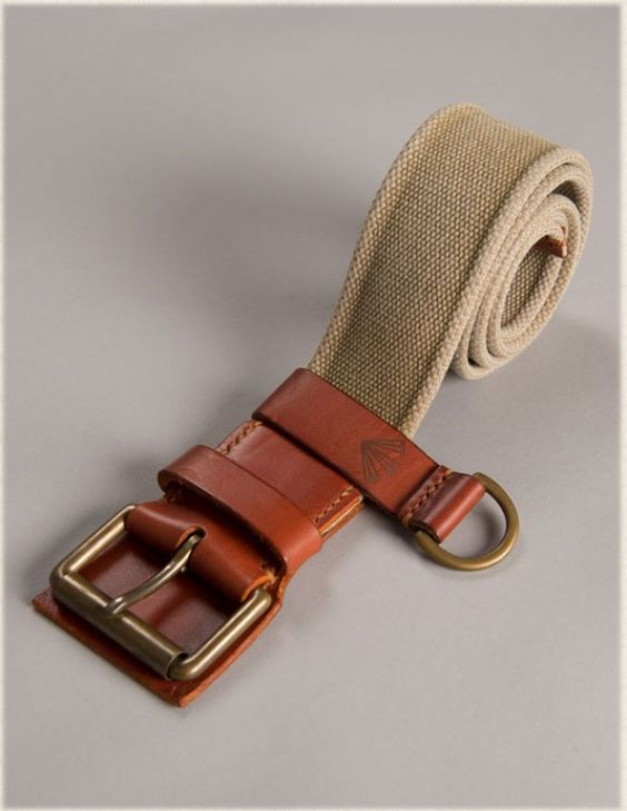 This military style canvas belt with leather trim, based on WWII standard issue belt, has been made in collaboration with Taylor Kent Co, specialists in English handmade canvas and leather belts and bags. Canvas Belt by Nigel Cabourn.