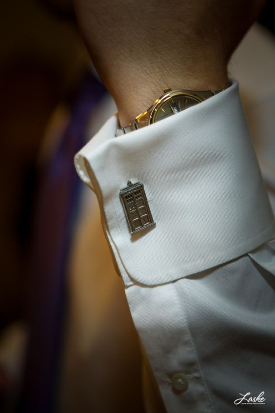 Tardis cufflinks on the groom at a Doctor Who-themed wedding---I made a sonic screwdriver out of a pen and duct tape if anyone wants to know-LK