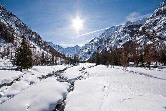 The sun beams down on the smooth snow of Valnontey Valley, located within Italy's Alps.